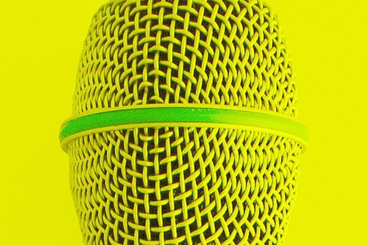 an close up photo of a microphone that has been coloured yellow