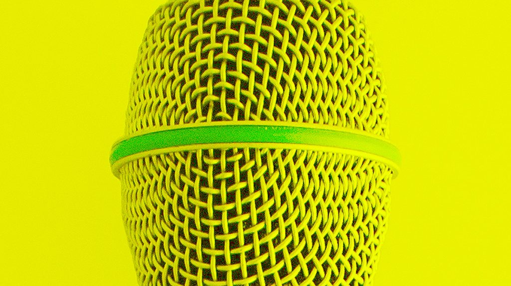 A close up photo of a microphone that has been coloured yellow