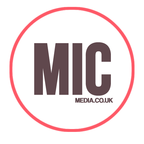a circle. the outline colour is pink, inside is white. Also inside the circle is the word MIC in large grey letters. Under the I and C of MIC is the words MEDIA.CO.UK, also in dark grey